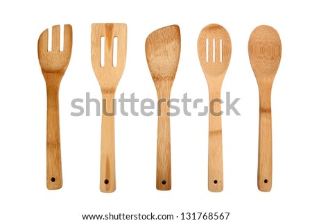 Wooden Kitchen Utensils. Isolated with clipping path. - stock photo