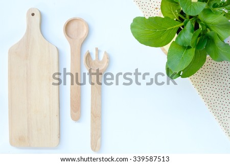 Wooden kitchen utensils on white wood tabletop.  - stock photo