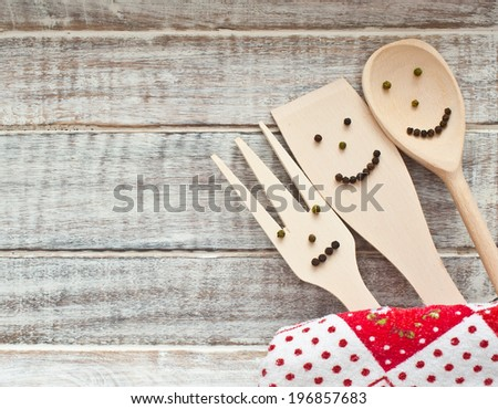 Wooden kitchenware on cutting board abstract food background - stock photo