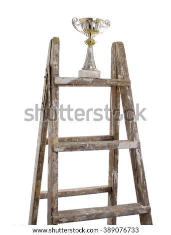 Wooden ladder with a trophy on the top, isolated on white background - stock photo