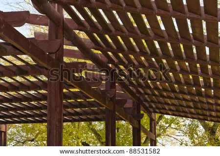 Wooden lattice. The roof of a street cafe made ??from wooden slats - stock photo