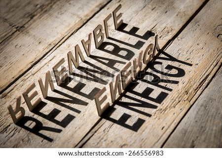 wooden letters on old aged wooden table build the shadow word renewable energy, vintage style - stock photo