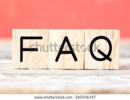 Wooden letters spelling FAQ - stock photo