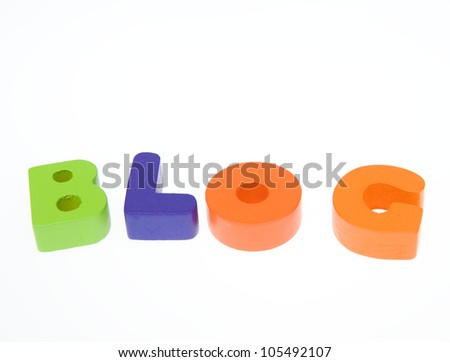 """Wooden letters spelling the word  """"blog""""  on white background. - stock photo"""
