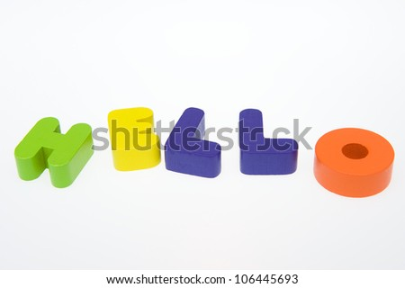 """Wooden letters spelling the word  """" hello """"  on white background. - stock photo"""