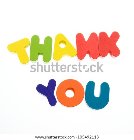 """Wooden letters spelling the word  """"thank you""""  on white background. - stock photo"""
