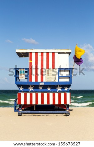 wooden life guard huts in art deco style at south beach - stock photo