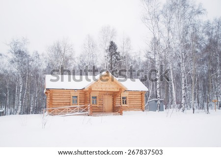 Wooden log house in winter forest, Siberia, Russia - stock photo