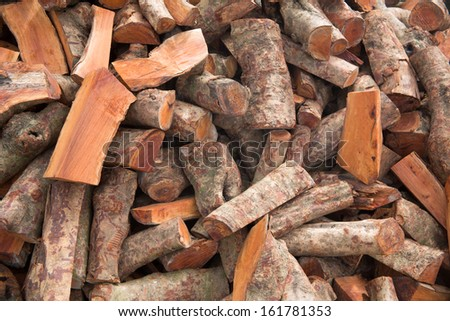 Wooden logs saved for the winter - stock photo