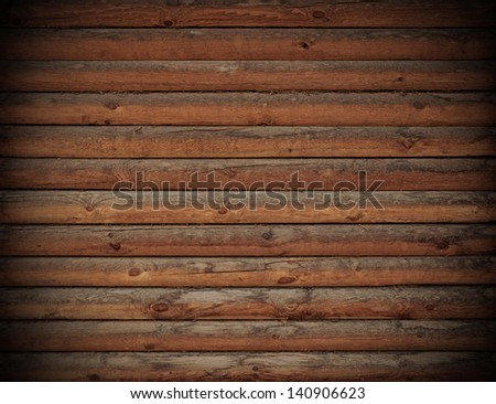 Wooden logs wall of rural house background - stock photo