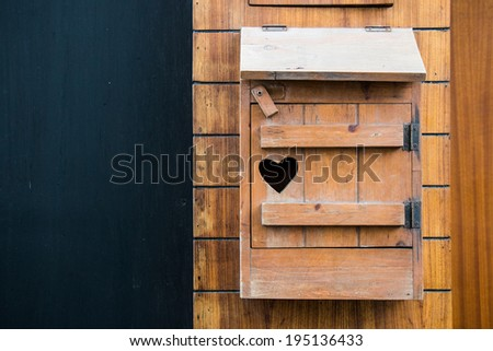 Wooden mailbox with heart shape with copy writing space - stock photo