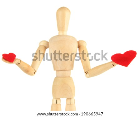Wooden mannequin holding red hearts isolated on white - stock photo