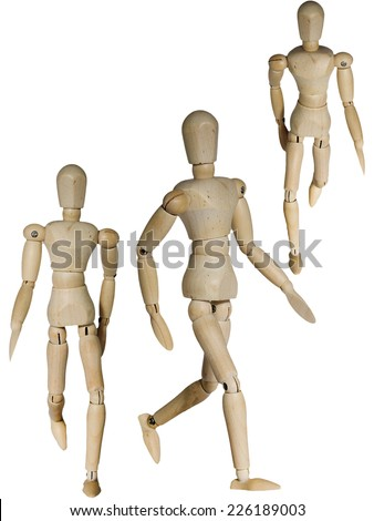Wooden mannequin in three different walking pose isolated on white - stock photo