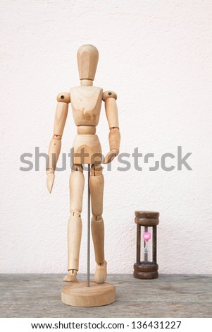Wooden mannequin pose in concept of progress time - stock photo