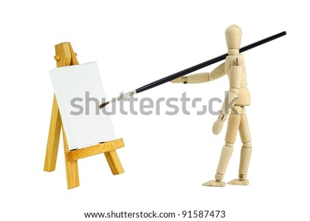 Wooden mannequin with an easel with a blank canvas to be used for text and other purposes by the designer - stock photo