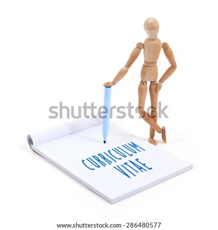 Wooden mannequin writing in a scrapbook - Curriculum vitae - stock photo