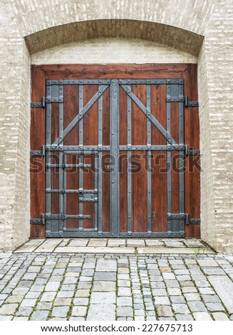 Wooden massive door in an ancient fortress Europe. - stock photo