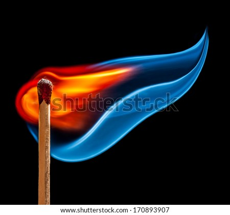wooden match is burning on black background - stock photo