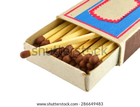 Wooden matches in a box of cardboard isolated on white background - stock photo