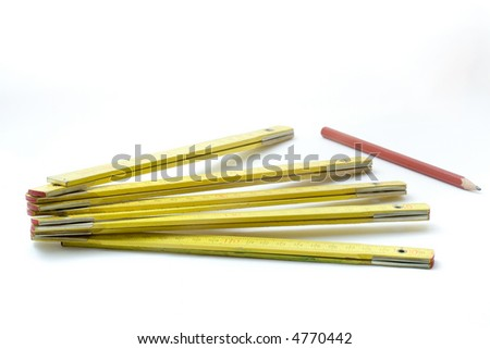 wooden measuring tool with pencil - stock photo