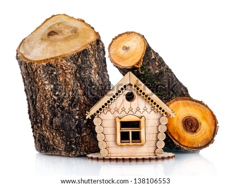 Wooden model of house and stack of wood. Concept - stock photo