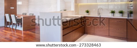 Wooden modern interior - kitchen and dining room - stock photo