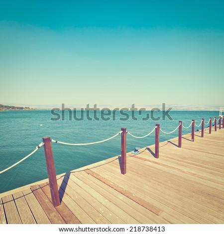 Wooden Mooring Line on the Galilee Sea, Kinneret, Instagram Effect - stock photo