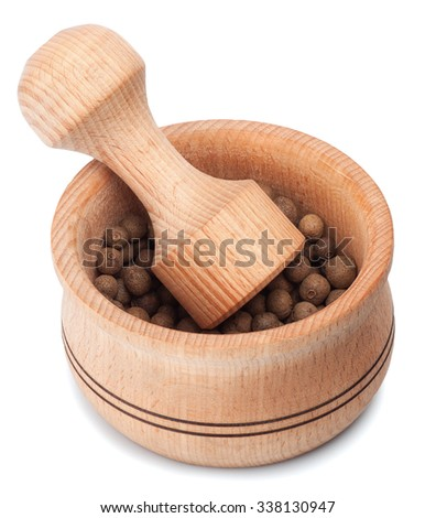 Wooden mortar and pestle with allspice isolated on white  background - stock photo