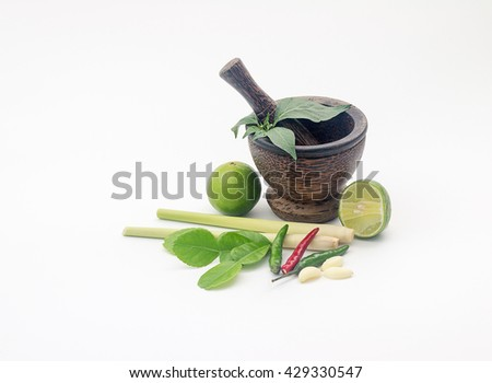 Wooden mortar.Fresh flavoring herbs and spices in wooden mortar. - stock photo