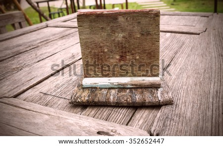 Wooden nameplate on table  vintage color tone - stock photo