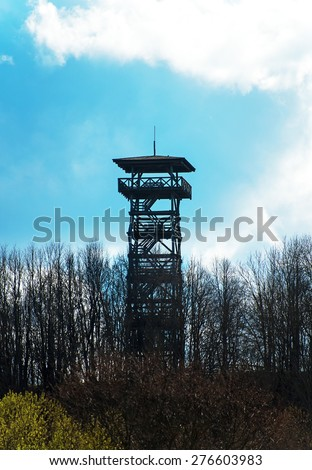 Wooden observation tower in the forest. - stock photo