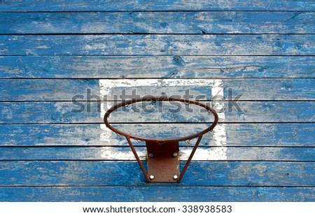 Wooden old basketball backboard on the street - stock photo