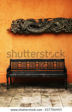Wooden old chair with thai craft background . - stock photo
