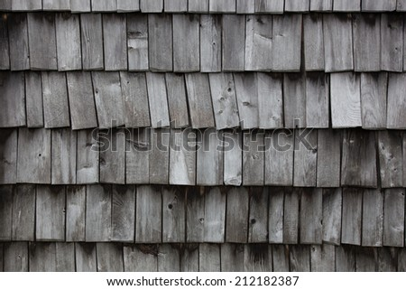 Wooden old retro style roof on old house - stock photo