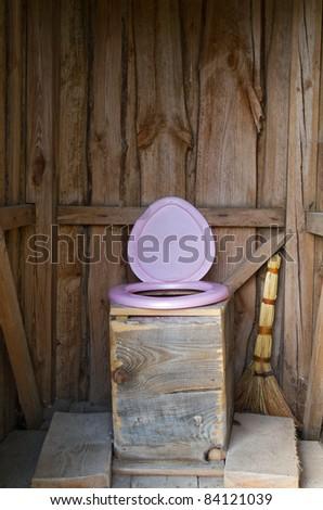 wooden outside toilet - stock photo