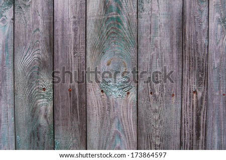 Wooden Palisade background. Close up of grey and green wooden fence panels. Vintage wood background. Old wooden fence. wood texture background. wood fence background. Wood wall - stock photo