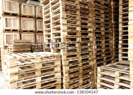 Wooden pallet in warehouse - stock photo