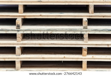 Wooden pallet is stacking in the warehouse of factory. - stock photo