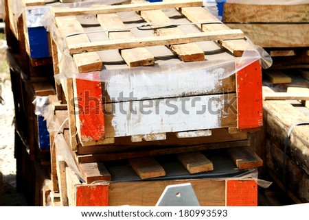 Wooden pallets bunch in warehouse - stock photo