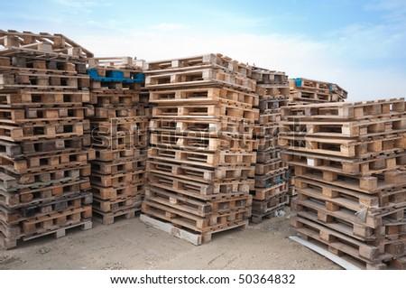 Wooden pallets in an enterprise warehouse. - stock photo