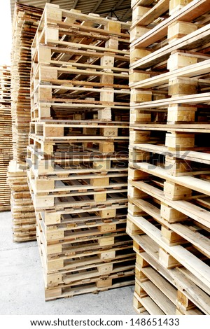 Wooden pallets in warehouse - stock photo