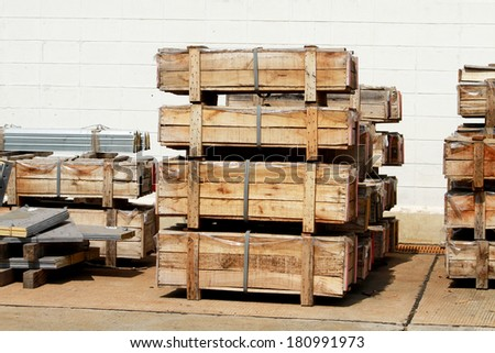 Wooden pallets of steel bolt in warehouse - stock photo