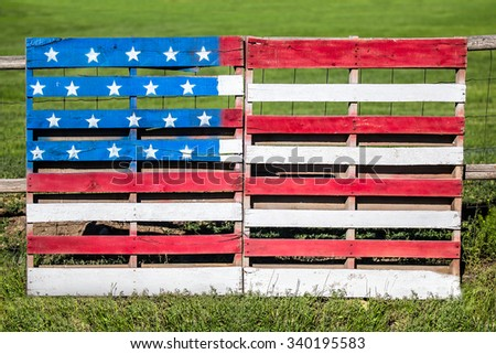Wooden pallets repurposed and painted with the American flag celebrate the American spirit. - stock photo
