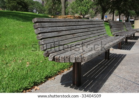 wooden park benches in urban downtown - stock photo