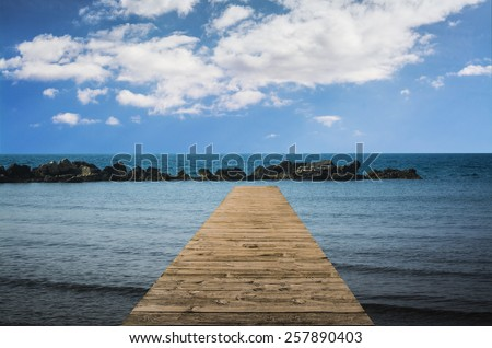 Wooden path and blue sky - stock photo