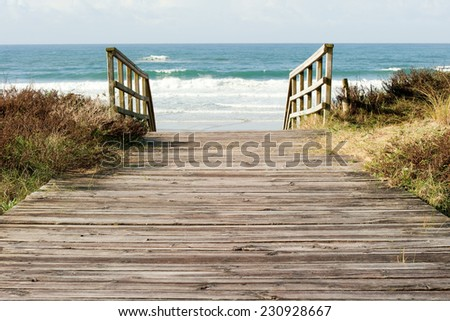 wooden pathway to the sea - stock photo
