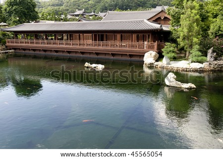 Wooden Pavilion in Chi Lin Nunnery in front of a lake, Hong Kong - stock photo