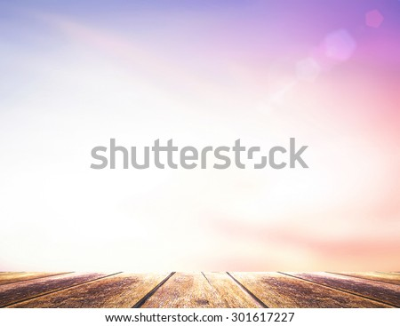 Wooden paving and abstract blurred beautiful sky textured background: purple pink and blue patterns. International Mountain Day, Happy Valentine's Day, Love, Romantic concept. - stock photo