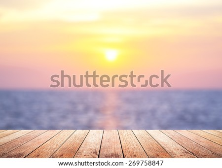 Wooden paving with blurred beautiful sunset background. - stock photo
