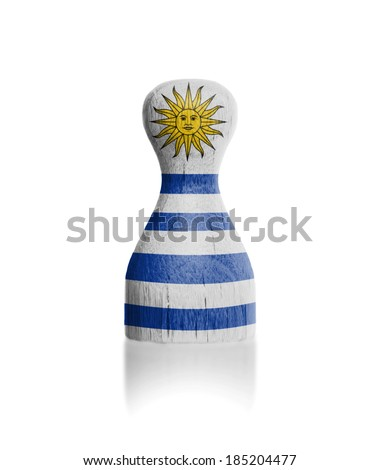 Wooden pawn with a painting of a flag, Uruguay - stock photo